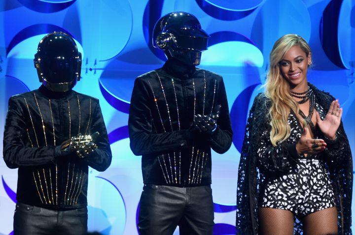 Beyonce sports a smile next to Daft Punk.