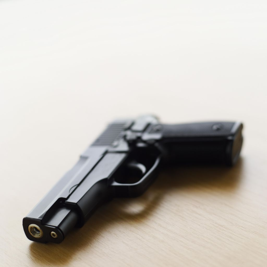 A gun on a table