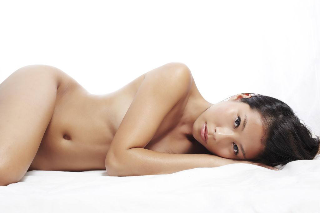 Beautiful young Asian woman laydown. Nude