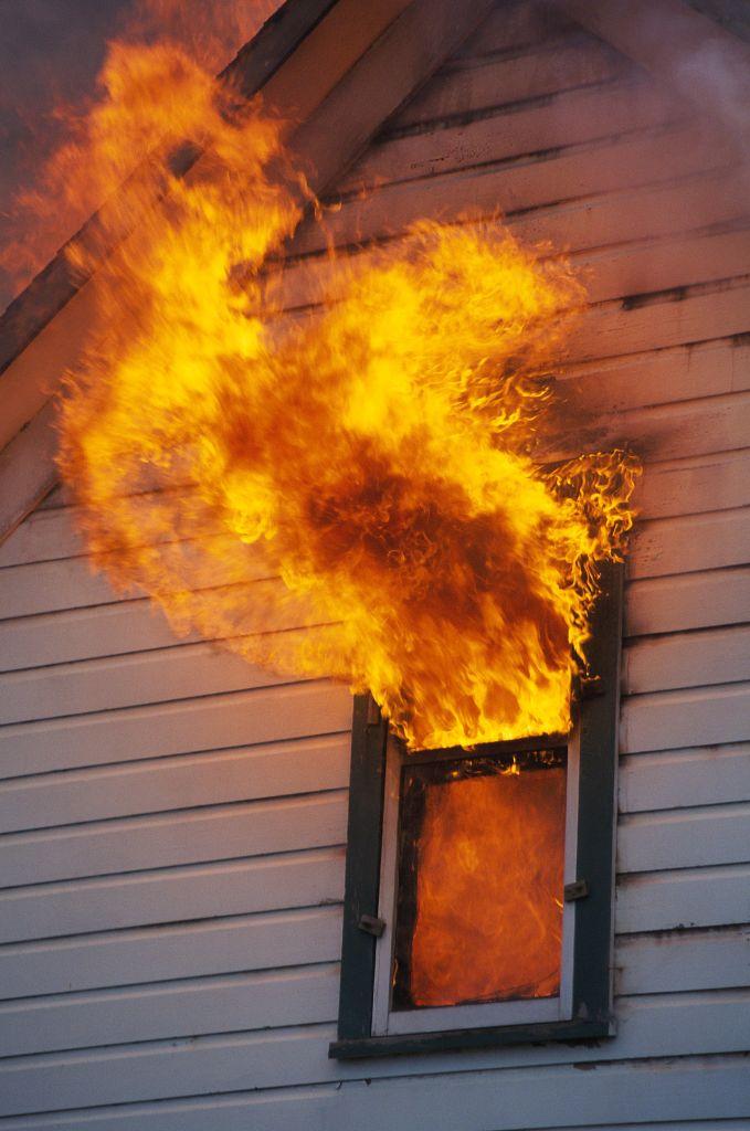 House burning, flames shooting through window