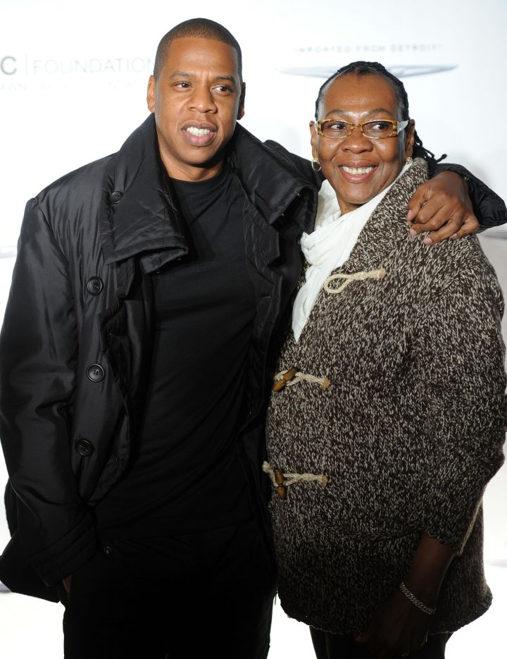 Jay Z embraces his mom Gloria Carter and shows off his millionaire dollar smile.