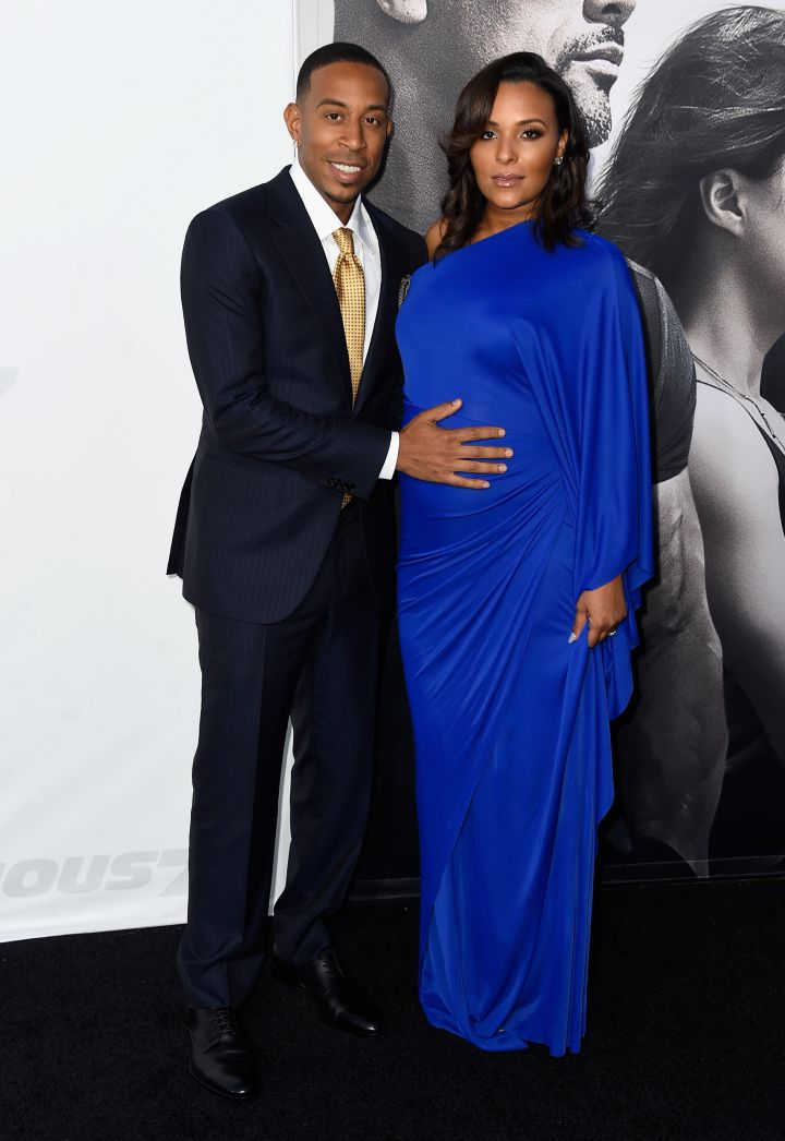 """Ludacris and his pregnant wife Eudoxie Mbouguiengue at the """"Furious 7"""" premiere. (2015)"""