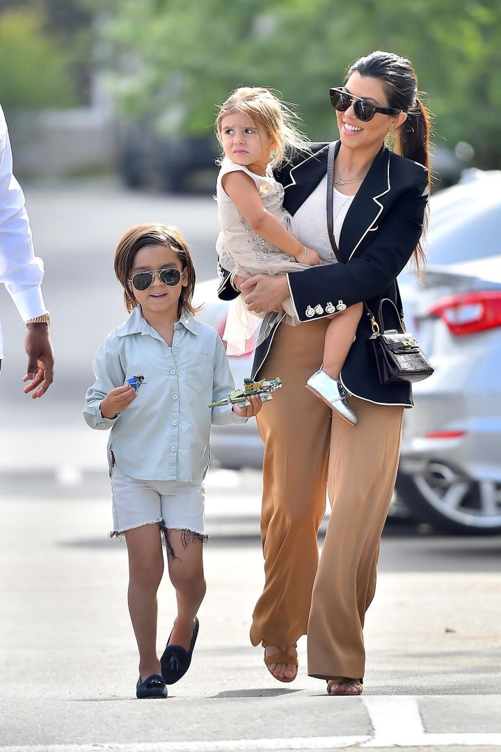 Kourtney carried Penelope as Mason kept it casual while heading into church.
