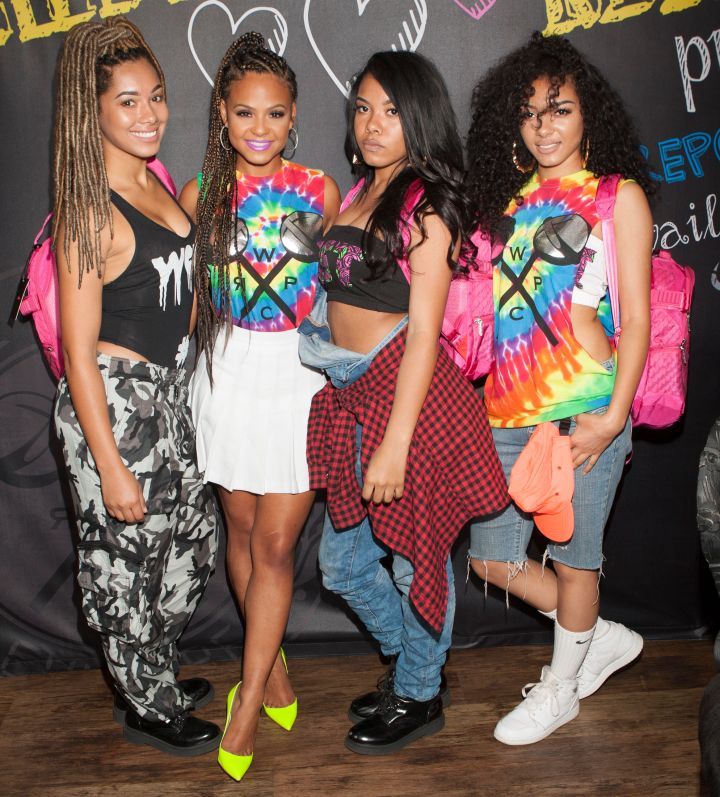 Saiyr, Christina Milian, Znuie, and Emaza attend as Christina Milian brings We Are Pop Culture to Shiekh Shoes on April 8, 2015 in West Hollywood, California.