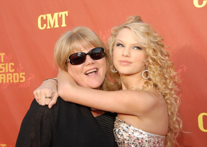 Taylor's Got A Tight Hold On Her Mommy.