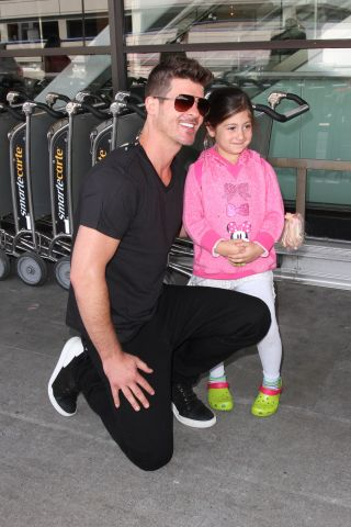 Robin Thicke greets some young eager female fans as he arrives in Los Angeles.