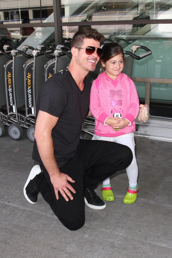 Robin Thicke greets young fans as he arrives in Los Angeles.