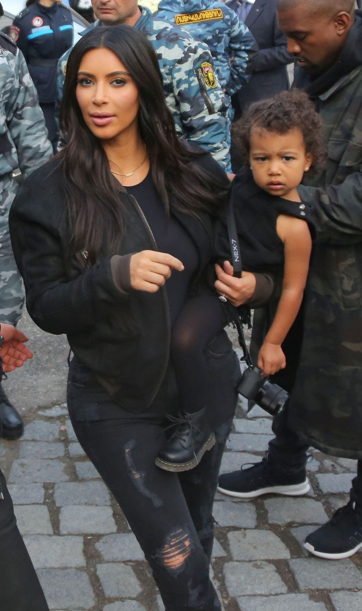Kim carried North around on her hip throughout the day.