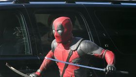 Ryan Reynolds, in costume as 'Deadpool' films a fight scene using two katana swords.