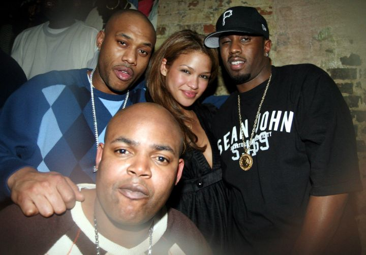 Mario Winans, Harve Pierre, Cassie, & Diddy Partying Together.