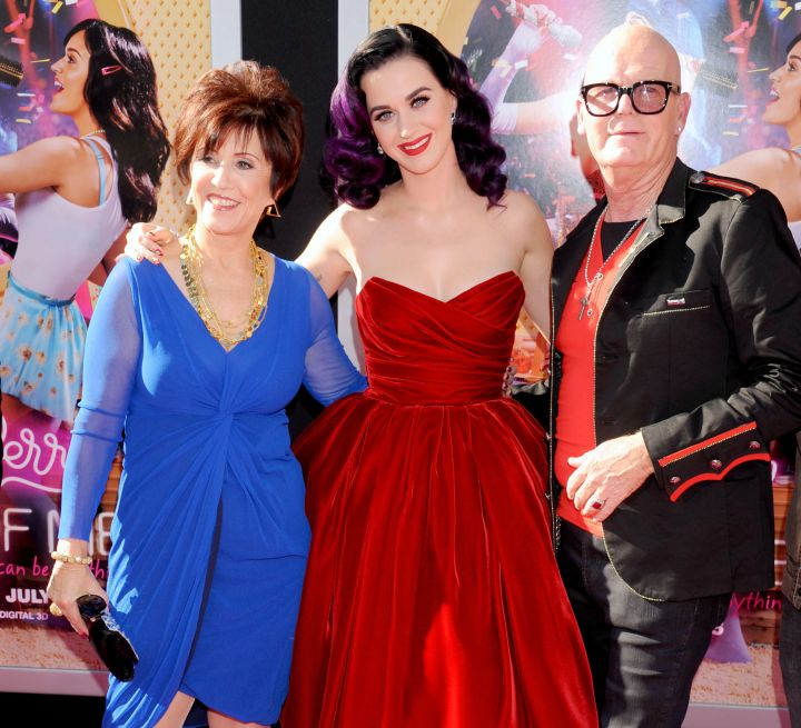 Keith Hudson and Mary Perry embrace their famous baby girl Katy on the red carpet.