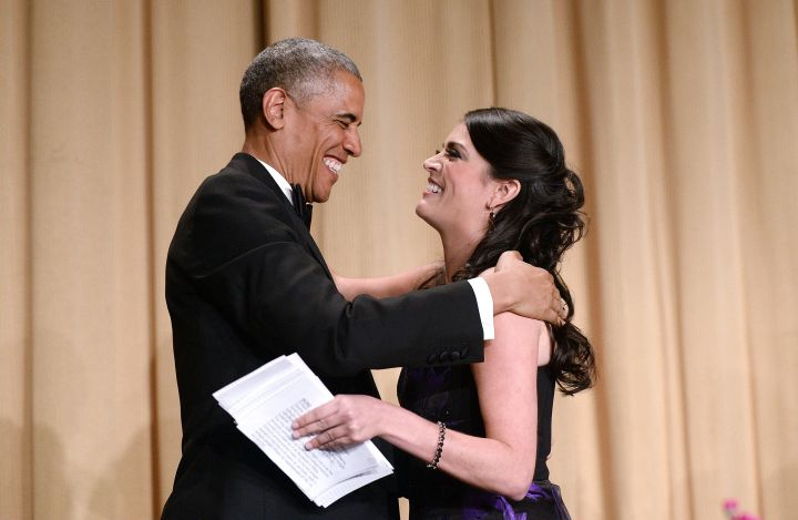 President Obama hugs host Cecily Strong