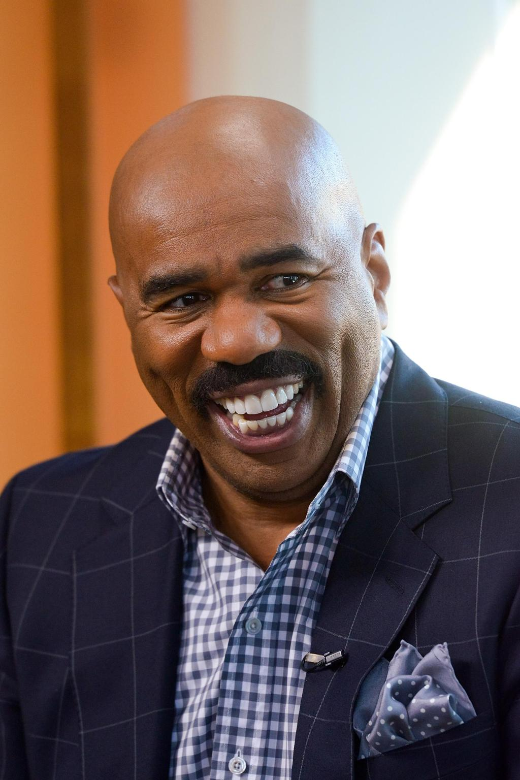 Steve Harvey, Erin Wasson And Howie Mandel At 'Extra'