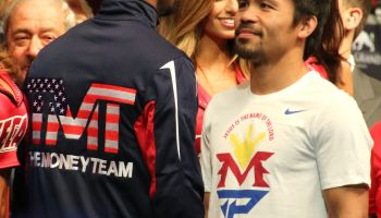 Mayweathe & Pacquaio face each other during the weigh-in 2015