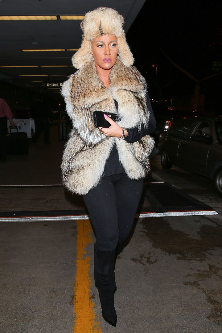 Amber Rose landed at LAX ready for winter in May as she rocked fur from her head to booty.