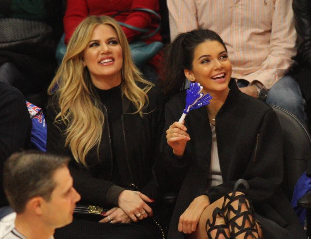 Khloe Kardashian and Kendall Jenner at Clipper basketball game in Los Angeles