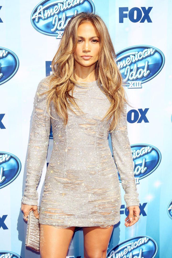 J.Lo flaunts her famous curves.