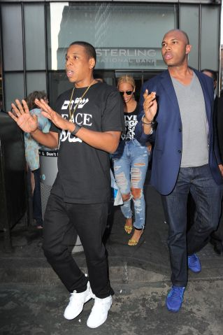 Jay Z steps up to defend his bodyguard after he was hit by a paparazzi outside of NYC offices