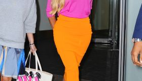 Beyonce rocking orange skirt and pink shirt in New York
