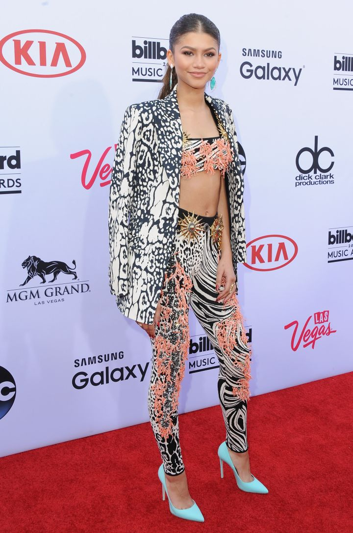 Zendaya kept things fun and stylish in a matching pant and top set paired with brightly colored pumps.