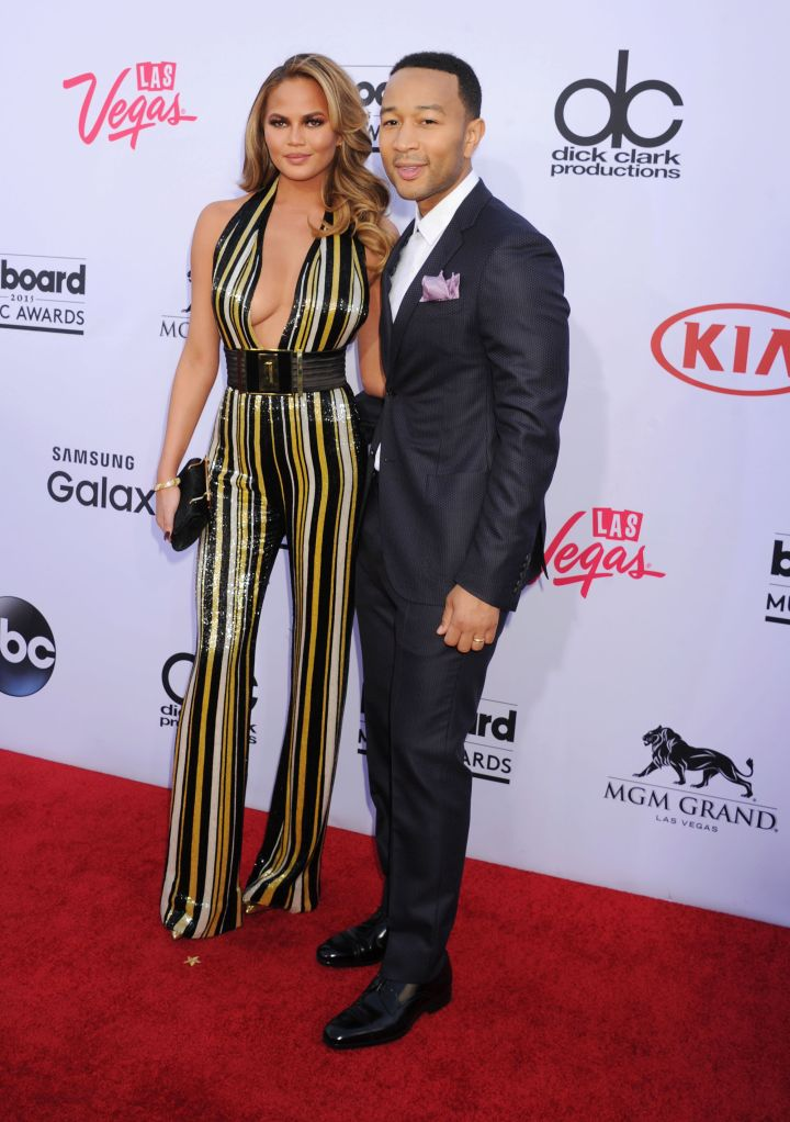 Chrissy Teigen and John Legend flashed million dollar smiles.