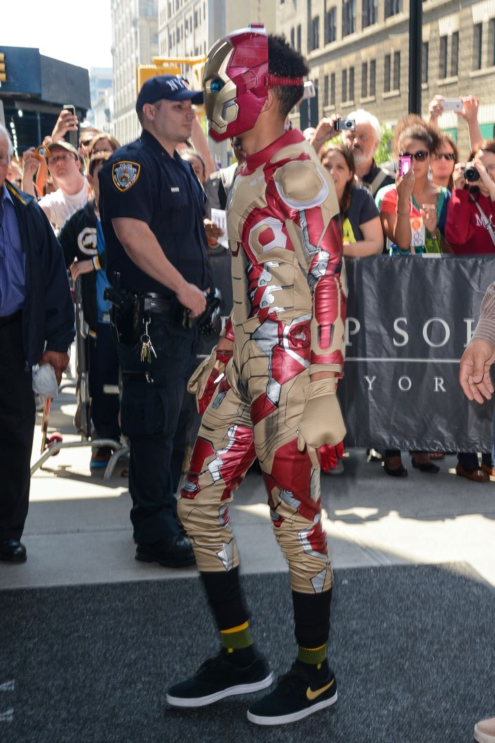 Jaden Smith walking around dressed as Iron Man.