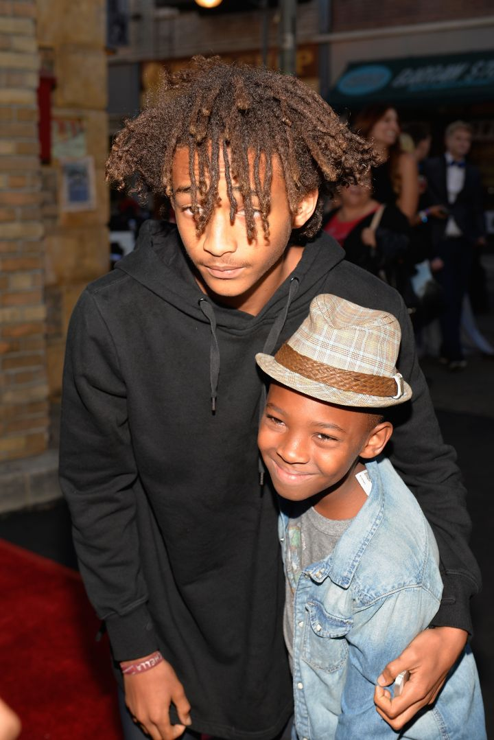 Jaden Smith really charged up to take a picture with a young fan.