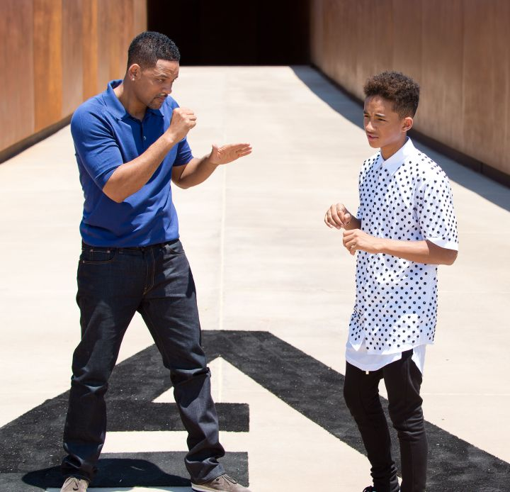 Jaden Smith learning how to box from his father.