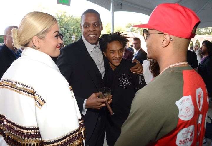 Jaden Smith being star struck by T.I. while hugging Jay Z.