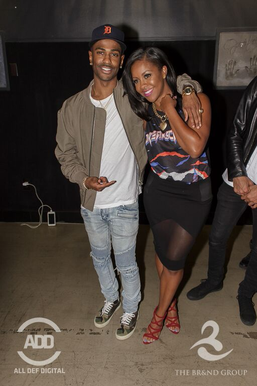 Big Sean kicking it with head woman in charge – Miss Diddy.