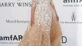 Celebrities attend the amfAR event in Cannes, France