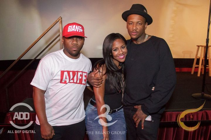 Miss Diddy cuddled up to YG for a picture with Brandon Moore.