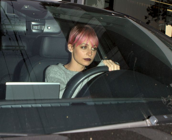 Nicole Richie and father Lionel were seen leaving Fred Segal after filming for Nicole's Reality TV show in West Hollywood, CA.
