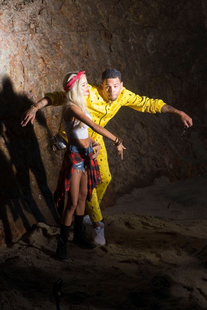 """Chris Brown and Pia Mia dance around in the sand during their """"Do It Again"""" music video shoot."""
