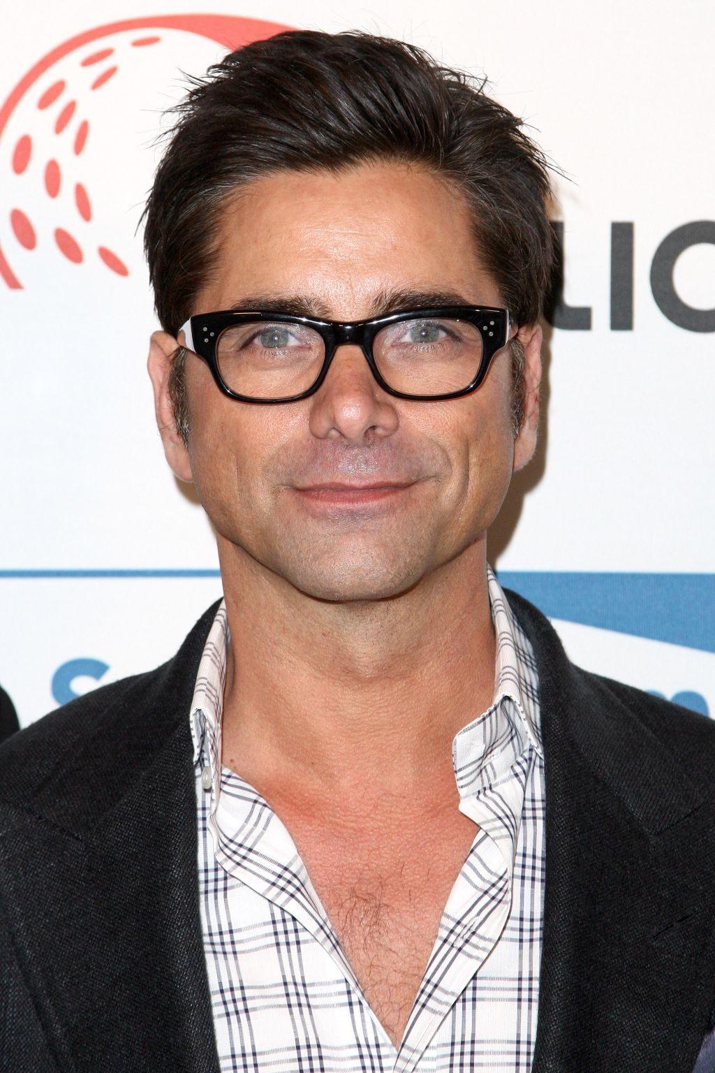 John Stamos attends the Cool Comedy Hot Cuisine Benefit June 5th in Beverly Hills