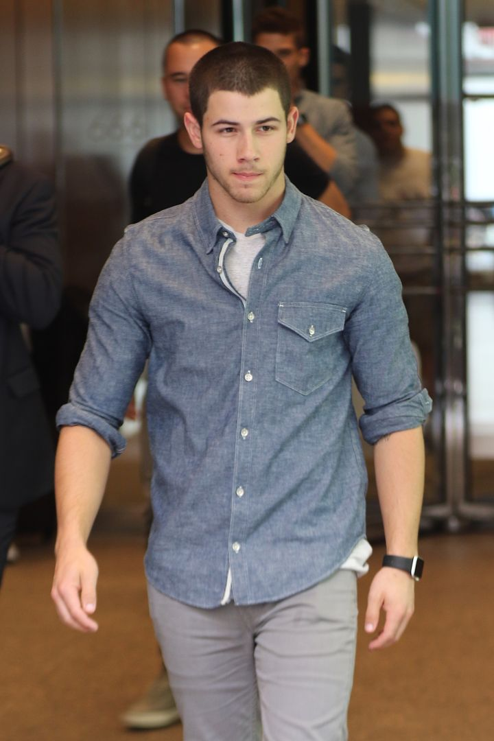 Nick Jonas sports the Apple Watch while out and about in NYC.