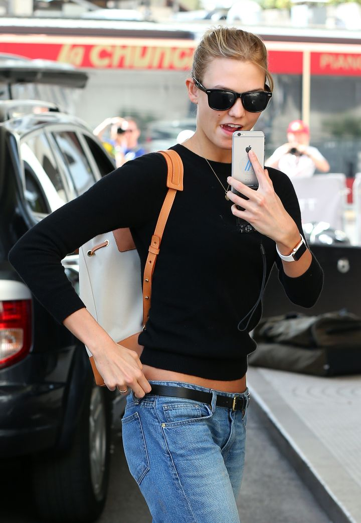 Karlie Kloss has some fun with the paparazzi while wearing the Apple Watch.