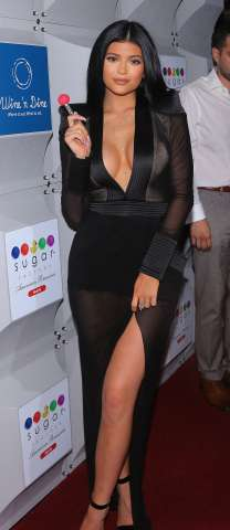 Kylie Jenner poses during the opening night of Sugar Factory in Miami