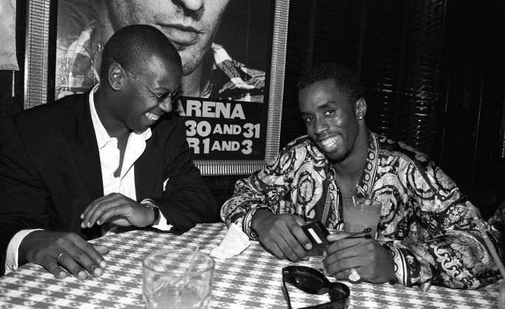 Diddy all laughs next to Andre Harrell.