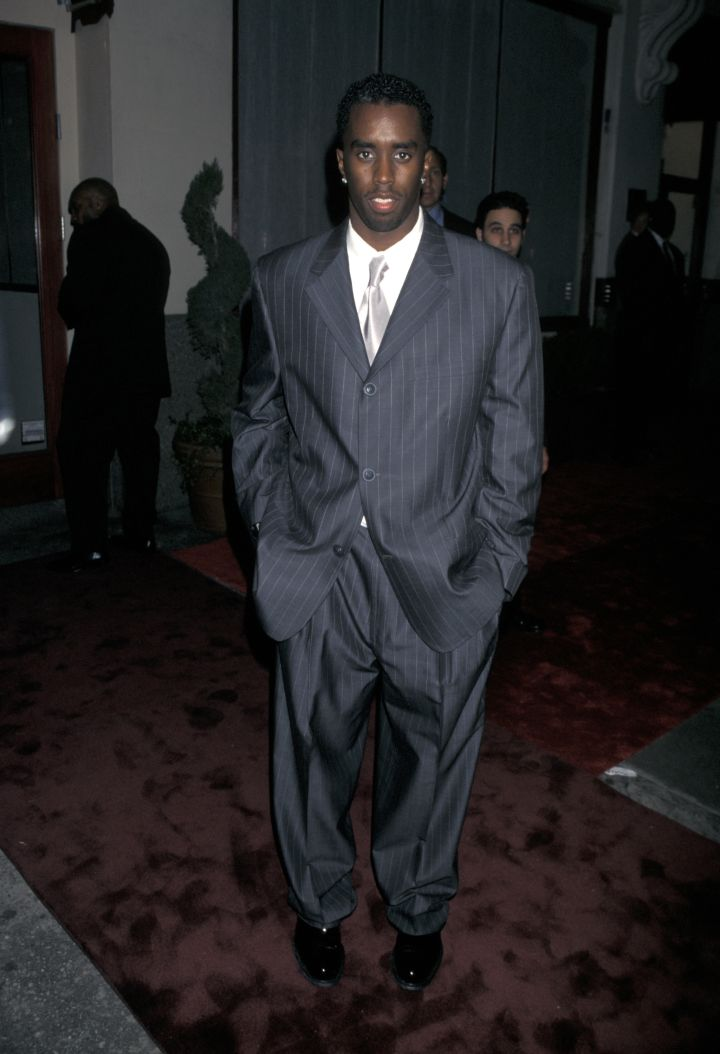 Diddy in a baggy suit.