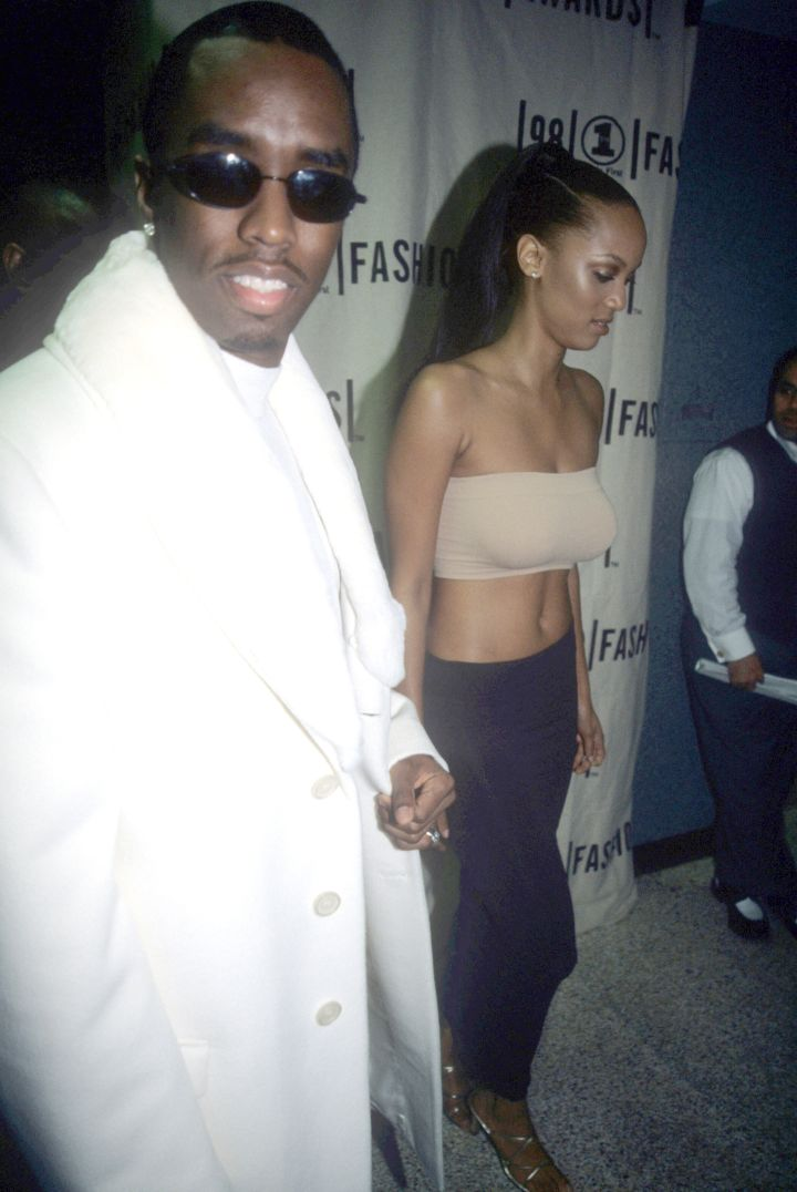 Diddy shining next to Tyra Banks.