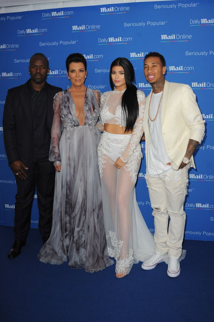 Tyga and Corey Gamble join their girls at DailyMail's Seriously Popular Yacht Party.