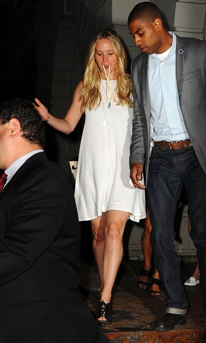 Jennifer Lawrence leaves Nobu in Tribeca with chopsticks in her mouth and a hunky guy on her arm.