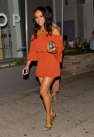 Karrueche Tran wearing a short Orange dress