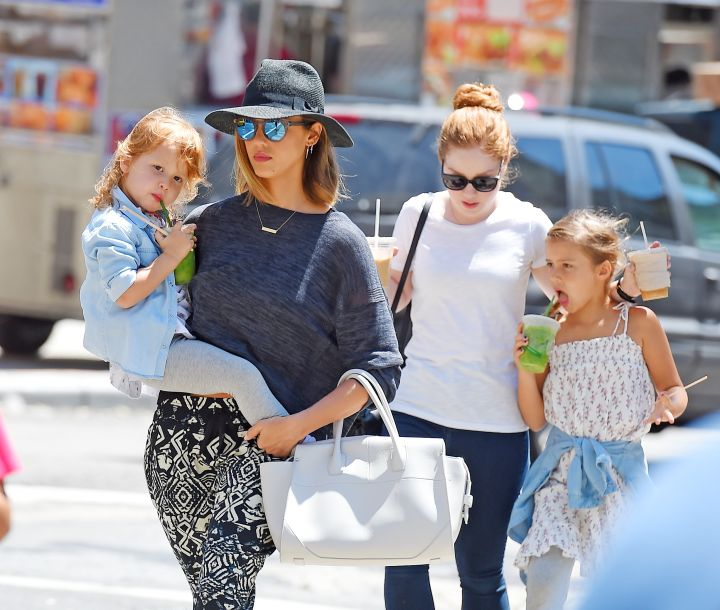 Businesswoman Jessica Alba holds daughter Haven in her arms, while Honor follows closely behind.