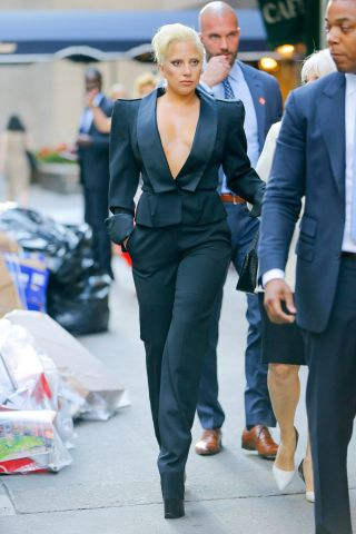Lady Gaga shows cleavage while heading to The Plaza Hotel