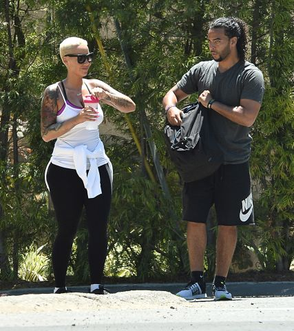 Amber Rose hiking with personal trainer
