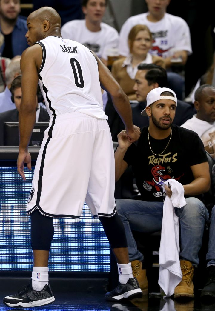 Drake spills tea courtside…