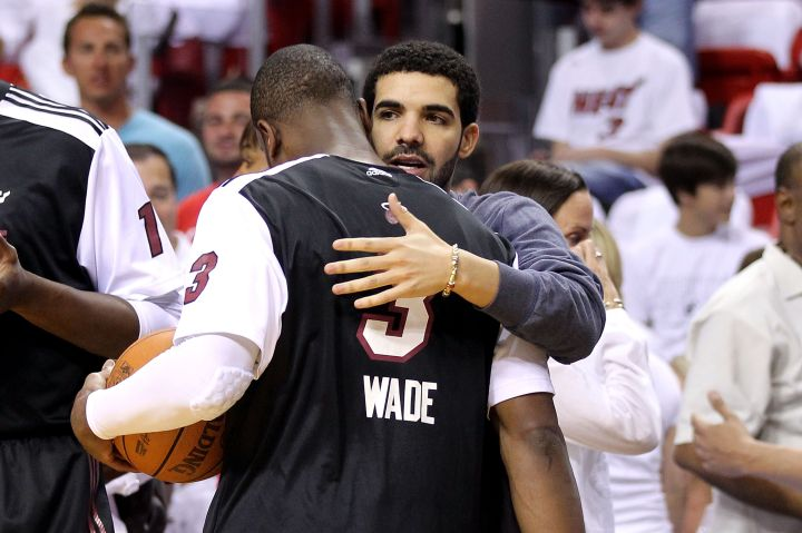 Drake and Dwyane Wade hug it out.