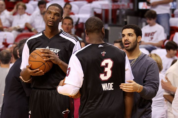 Drake chats it up with D-Wade and Chris Bosh courtside.